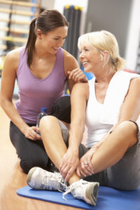 Cancer exercise specialist and client cancer exercise training institute
